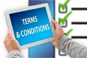 afbeelding van tablet met tekst: Terms & Conditions (algemene voorwaarden)